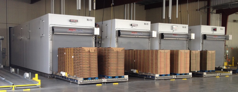 4 MACS Automated produce coolers loaded with pallets of strawberries. Western Precooling in Castroville, CA